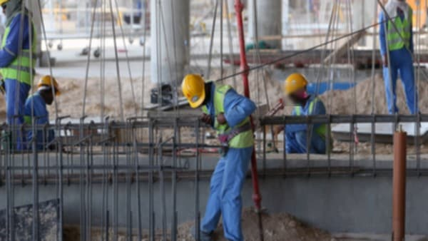 Migrant labourers work on a construction site on October 3, 2013 in Doha in Qatar. Qatar, the 2022 World Cup host is under fire over claims of using forced labour. Global football's governing body FIFA kicked off a crunch meeting behind closed doors, amid claims of rights abuses by Qatar and wrangling over plans to hold the tournament in the winter. AFP PHOTO / AL-WATAN DOHA / KARIM JAAFAR == QATAR OUT =